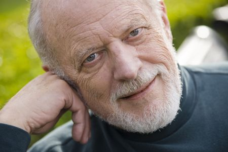 Portrait of an Old Gentleman Sitting on a Bench in a Park Stock Photo - 6263401