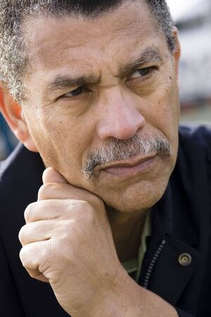 Portrait of an African American Man Looking Away From Camera Stock Photo