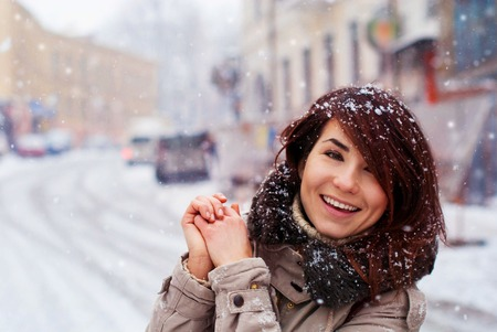 Young girl smiling at the first snow. The Winters Tale in the city.