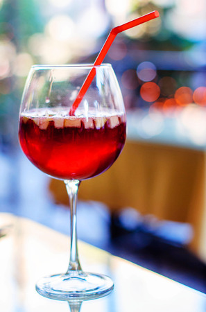 Spanish wine cold sangria drink in a glass with pieces of fruit and spices. Stock Photo