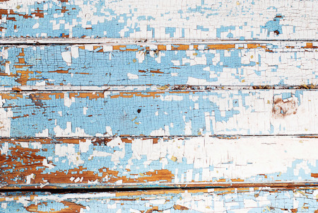 Wooden background of an old tree with cracked blue and white paint horizontal Stock Photo