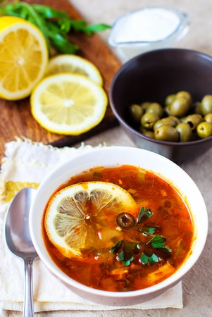 Solyanka Russian soup with olives and lemon.