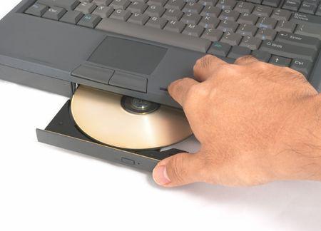 cd rom: Closing Laptop Computer CD ROM Drive