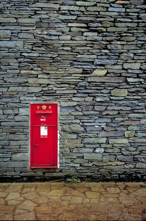 Red Letterbox on Stone wall photo