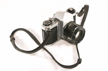 A vintage, old, reliable mechnical manual SLR camera. Well weathered yet reliable and dependable in the age of relying too much on electronics to do simple tasks. Stock Photo - 414778