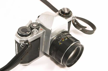 A vintage, old, reliable mechnical manual SLR camera. Well weathered yet reliable and dependable in the age of relying too much on electronics to do simple tasks. Stock Photo - 414777