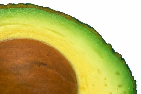 Avocado cut closeup, macro isolated white background photo