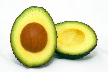 Avocado cut, isolated white background photo