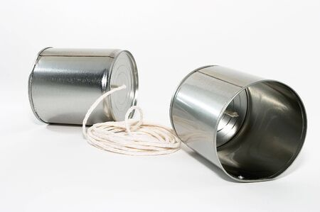 Telephones made out of tin cans and a string, emphasis on one sides tin can photo