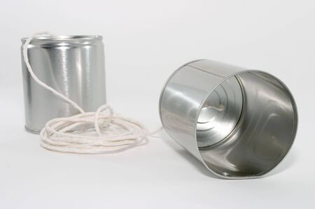 Telephones made out of tin cans and a string, emphasis on one sides tin can, up close photo