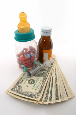emphasizes: high costs of children medication, bottle & pills, tall perspective and apparent tall bottle emphasizes high cost. Expensive health care for children  baby.