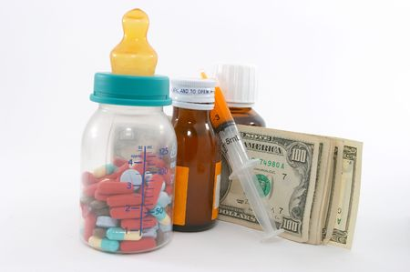 emphasizes: high costs of children medication, bottle & pills, tall perspective and apparent tall bottle emphasizes high cost. Expensive health care for children  . Pills in the milk bottle represents medication for children.
