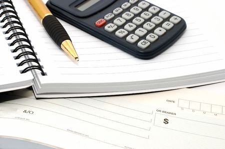 account executives: Note pad with pen, calculator, cheque book Stock Photo