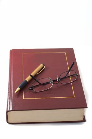 Book with pen and glasses, education and research, academic. photo