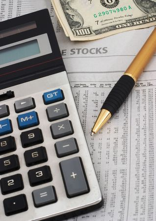 indicates: Stock market table analysis, calculator and pen indicates research and analysis, with cash, vertical orientation, cash indicates winnings, greed