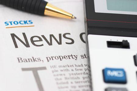 news values: Stocks News, pen, calculator, banks, property headlines, closeup, shallow depth of field Stock Photo