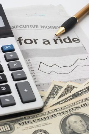 corporate greed: Stock chart analysis, calculator, with pen, vertical orientation. charts, analysis, ups and downs, closeup, cash, shallow depth of field Stock Photo
