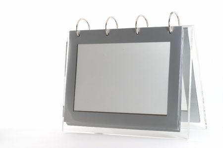 Ring binder empty photo frame, clear frame, gray, on white, seen form angle with space on left photo
