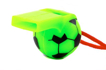arbiter: Green Soccer Ball whistle with red string. Mostly the whistle, close up, macro type shot Stock Photo