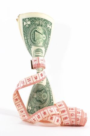 Measuring tape over money, budgeting, measure money, tight budget. Money upright. Could also signify expensive slimming treatment. Stock Photo - 574601