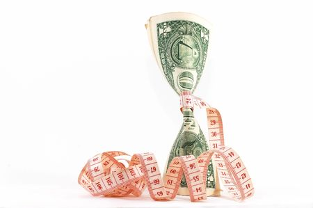 Measuring tape over money, budgeting, measure money, tight budget. Money upright. Could also signify expensive slimming treatment. Tape unravel, landscape orientation. Stock Photo - 573444