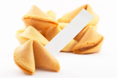 good fortune: Chinese fortune cookies, on white background, with a white piece of paper for entering own textfortune, shallow depth of field Stock Photo