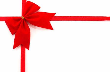 orientation: Gift wrap on a white background, top view, horizontal orientation, tilted bow.