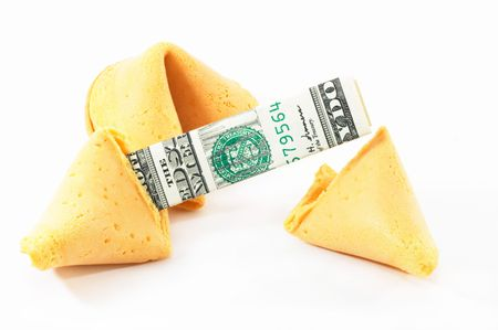 Chinese Fortune Cookie open with money, cash neatly folded inside the snack, on white background photo