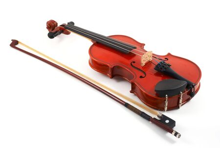 angled view: Violin with bow on side on white background, top, angled view