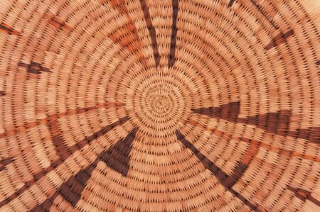 randomness: Circular woven pattern straw hat background, gives a sense of depth, symmetry, and randomness. Symbolizes the sun, summer