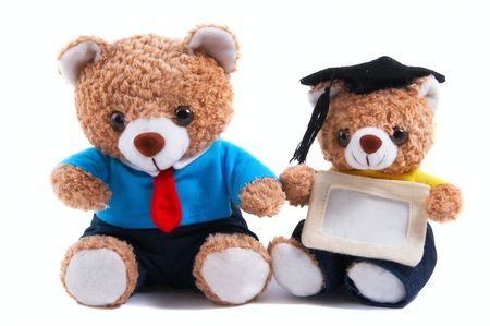 smaller: Smart looking teddy bear in shirt and tie. Business, office attire with necktie. Smaller teddy bear with graduate hat Stock Photo