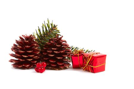 Christmas pine cones, pine leaves, presents isolated on white background. Horizontal, landscape orientation. Stock Photo - 2121233