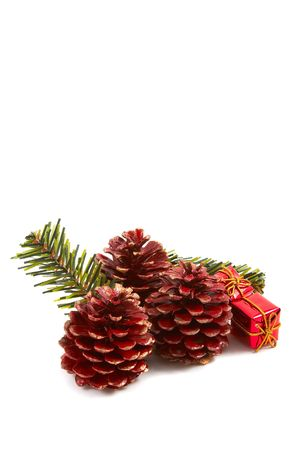 Christmas pine cones, pine leaves, presents isolated on white background. Vertical, portrait orientation. Stock Photo - 2121232
