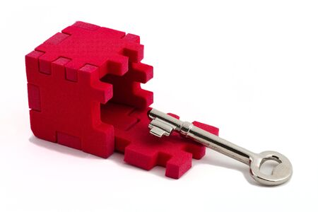 Key with a cube puzzle. Concept of solving problems. Isolated on white background. Stock Photo - 4656787