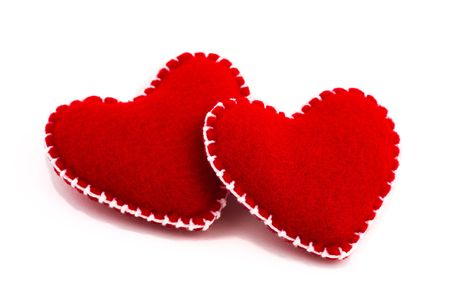 Two stuffed hearts together. Isolated on white background photo