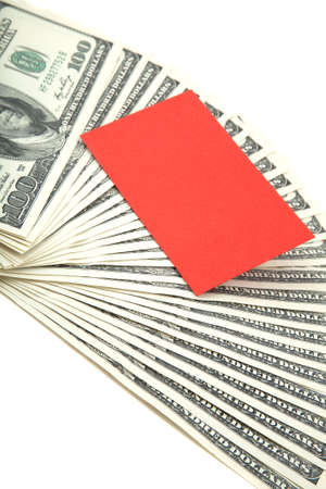 financials: Spread of cash on white background with red blank card for text Stock Photo