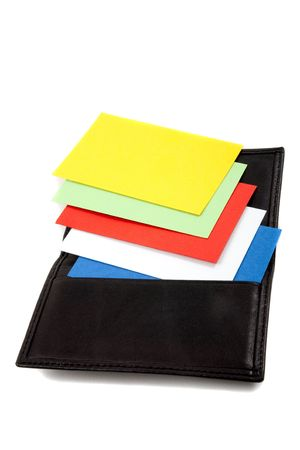 Stack of colorful cards in card holder. Business cards blank for adding own text photo