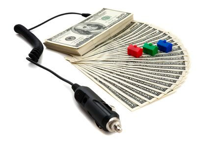 signify: Charger plugged into money to signify recharging, refinancing the money to finance Stock Photo