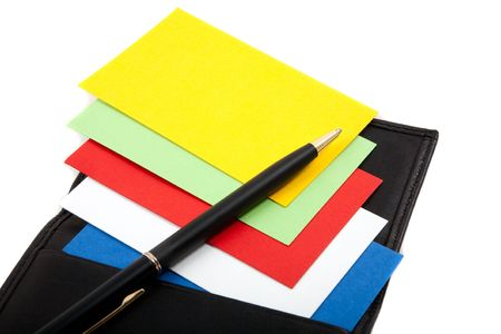 casing paper: Colorful blank business cards spread out in leather card holder, with pen.