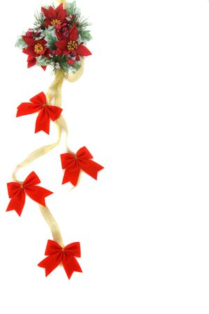 Poinsettia Christmas decoration, nice green and reds color combination, with gold ribbon and red bow. photo