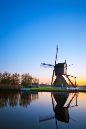 A Dutch windmill at Kinderdijk - a famous landmark, featuring 19 windmills at the same location, built around 1740  photo