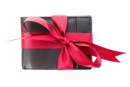 A black leather men s wallet with a red ribbon over a white background  Stock Photo