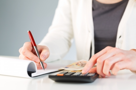 A female accountant recording financial information or making calculations  Stock Photo
