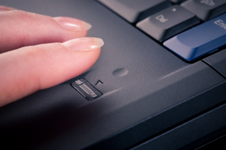 accessing: Female accessing a secure computer with a fingerprint reader  Closeup image  Stock Photo