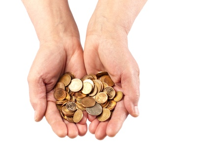 Two elderly hands holding a pile of coins  Viewed from top and isolated on white with copy space  photo