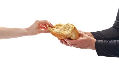 A keze egy fiatal nő vesz kenyeret Communion Stock fotó