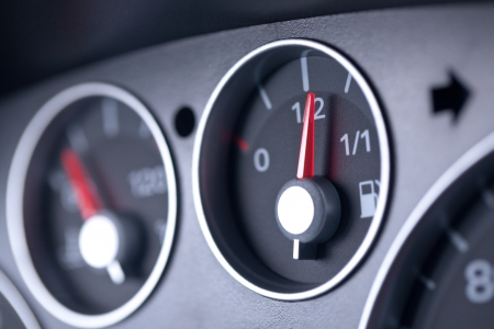 A closeup on the dashboard of a modern car with focus on the fuel indicator. Shallow DOF. photo