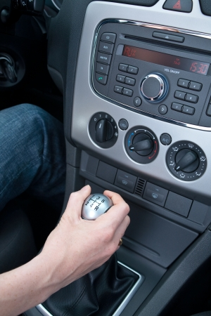 Interior of a modern vehicle with a hand changing gears Stock Photo - 20224354