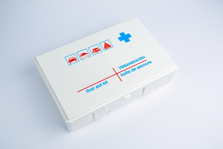 A white plastic first aid kit box over a plain background.