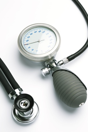 A blood pressure meter or sphygmomanometer and a stethoscope over a white background  photo